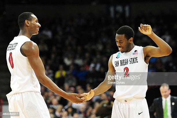 Skylar Spencer and Xavier Thames of the San Diego State Aztecs celebrate their 63 to 44 win over the North Dakota State Bison during the Third Round...