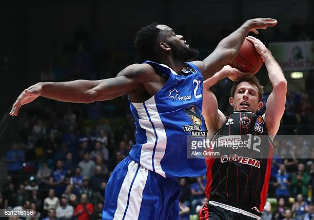 Skyler Bowlin of Giessen is challenged by Mike Morrison of Frankfurt during the easyCredit BBL match between Fraport Skyliners and Giessen 46ers at...