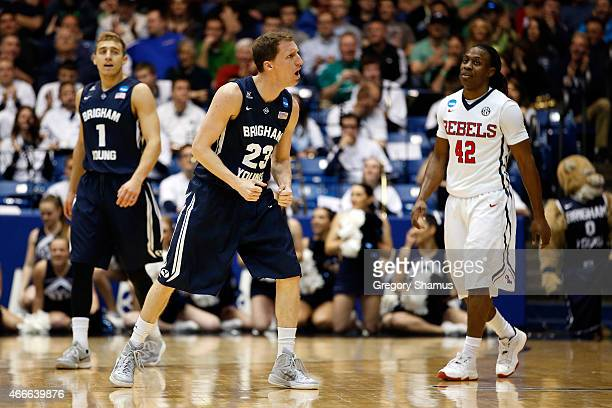 Skyler Halford of the Brigham Young Cougars reacts after hitting a shot against the Mississippi Rebels during the first round of the 2015 NCAA Men's...