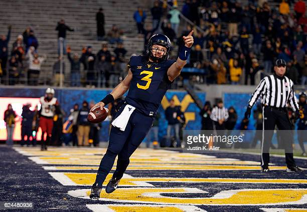 Skyler Howard of the West Virginia Mountaineers celebrate his 6 yard second half touchdown against the Oklahoma Sooners on November 19 2016 at...