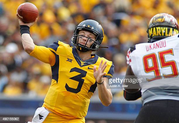 Skyler Howard of the West Virginia Mountaineers drops back to pass during the game against the Maryland Terrapins on September 26 2015 at Mountaineer...