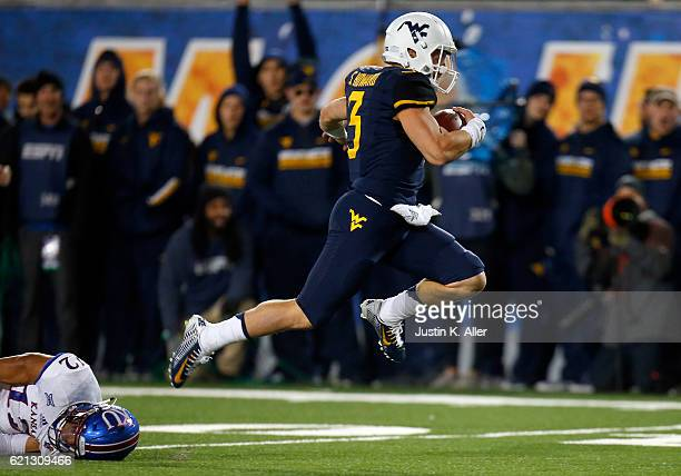 Skyler Howard of the West Virginia Mountaineers rushes for a 33 yard touchdown in the first half against the Kansas Jayhawks during the game on...