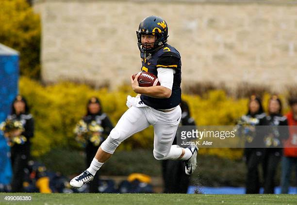 Skyler Howard of the West Virginia Mountaineers rushes in the first half during the game against the Iowa State Cyclones on November 28 2015 at...