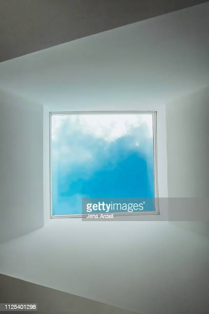 skylight, conceptual background, surreal background, vanishing point, diminishing perspective, blue sky, clouds, freedom - quadrado composição - fotografias e filmes do acervo