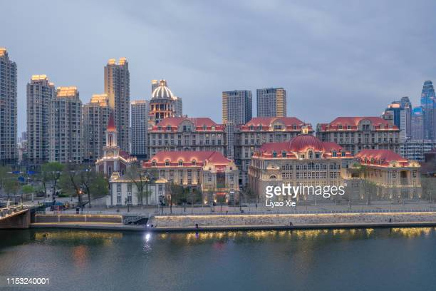 skyline along the river - liyao xie stock pictures, royalty-free photos & images