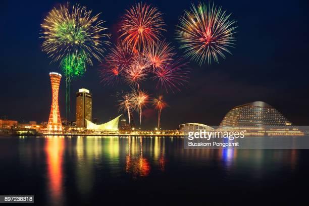 skyline and port of kobe tower with fireworks, osaka japan - 兵庫県 ストックフォトと画像