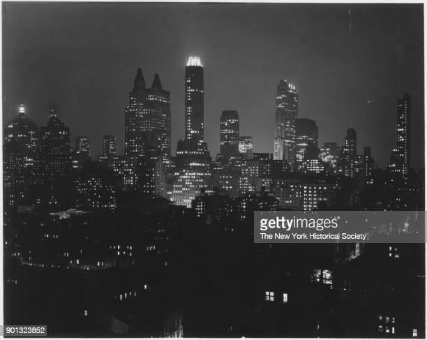 Skyline at night includes Waldorf Astoria GE Building New York New York 1929
