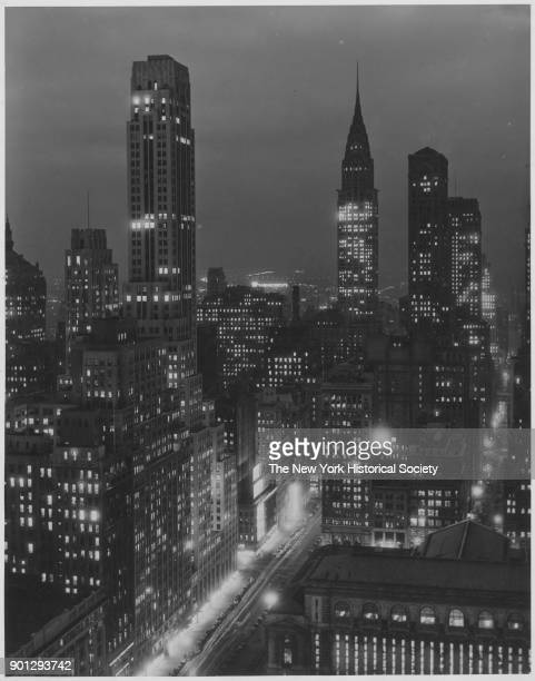 Skyline at night looking east across 42nd Street New York Public Library in foreground Chrysler Building beyond New York New York 1929