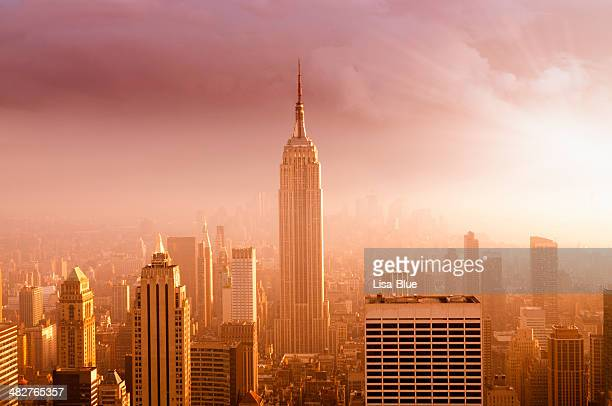 nyc skyline at sunset - empire state building stock pictures, royalty-free photos & images