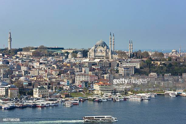 Skyline cityscape and the Blue Mosque and passenger ferry boat on Bosphorus River in Istanbul Republic of Turkey