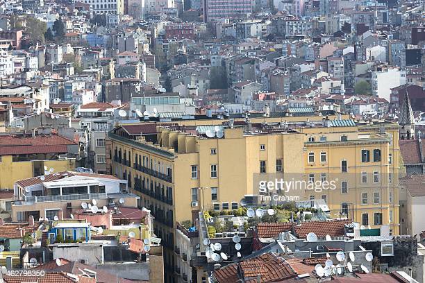 Skyline cityscape apartment blocks and offices of Karakoy and Beyoglu and satellite dishes infrastructure in Istanbul Turkey