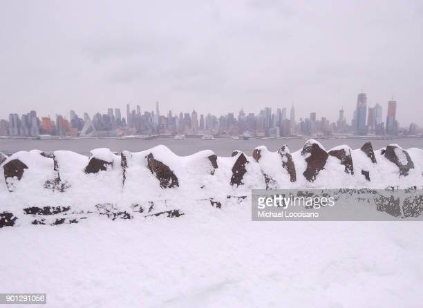 NYC skyline during a snow storm on January 4 2018 at Hamilton Park in Weehawken New Jersey As a major winter storm moves up the Northeast corridor...