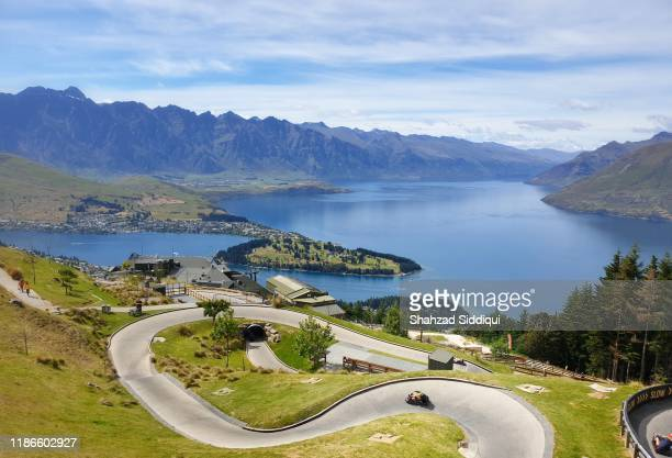 skyline luge ride in queenstown new zealand - luge stock pictures, royalty-free photos & images