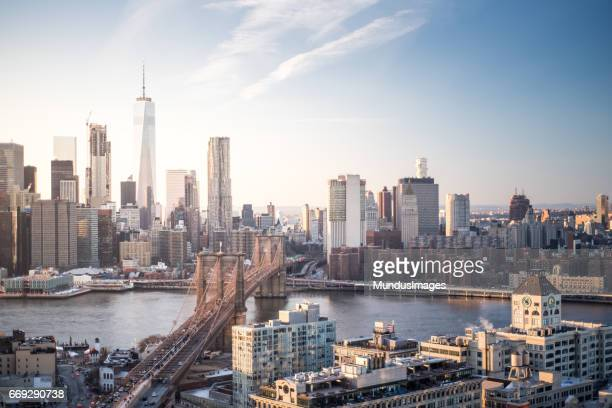 skyline new york city manhattan and brooklyn bridge at sunset - dumbo imagens e fotografias de stock