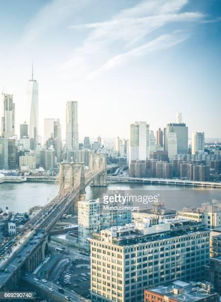 Skyline New York City Manhattan and Brooklyn Bridge At Sunset