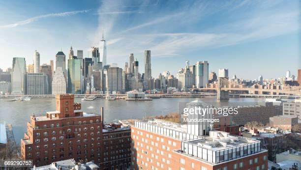 Skyline New York City Manhattan and Historic Buildings of Brooklyn Heights and the Brooklyn Bridge
