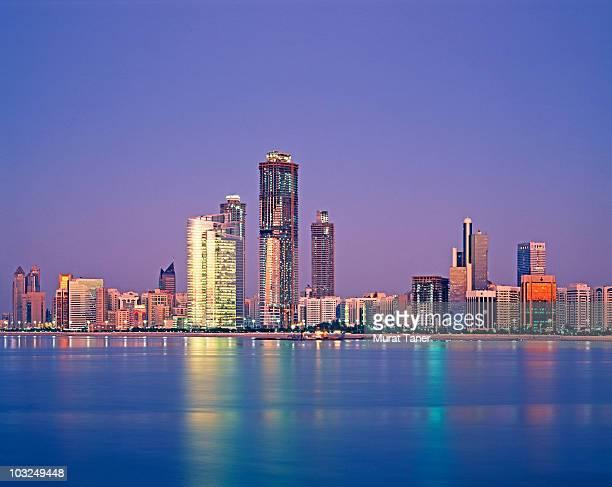 Skyline of a city at dusk