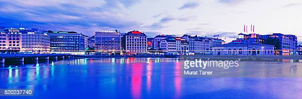 skyline of a city at dusk - geneva switzerland stock pictures, royalty-free photos & images