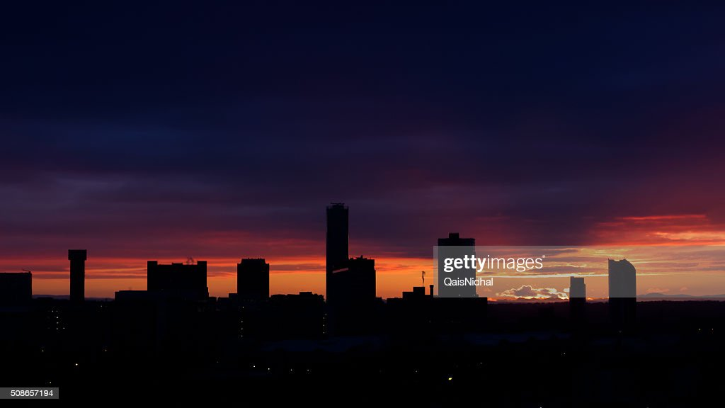 skyline of a city during sunset : Stock Photo