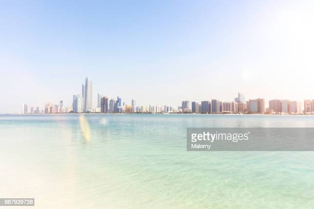 UAE, skyline of Abu Dhabi at the waterfront, beach