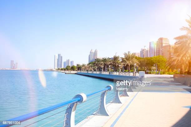 uae, skyline of abu dhabi at the waterfront - abu dhabi stock pictures, royalty-free photos & images