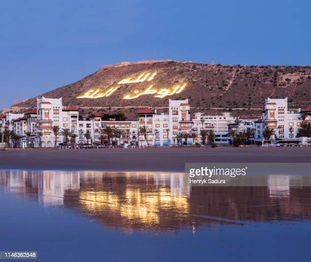 skyline of agadir at sunset in morocco - agadir stock pictures, royalty-free photos & images
