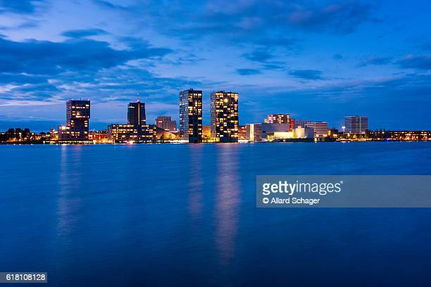 skyline of almere netherlands at dusk - almere stock pictures, royalty-free photos & images