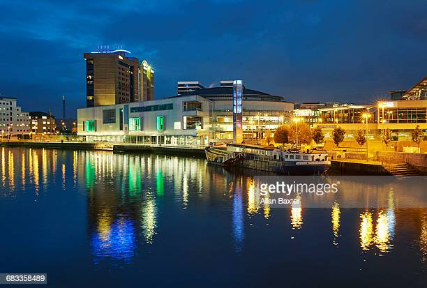 skyline of architecture in belfast along the lagan - belfast stock pictures, royalty-free photos & images