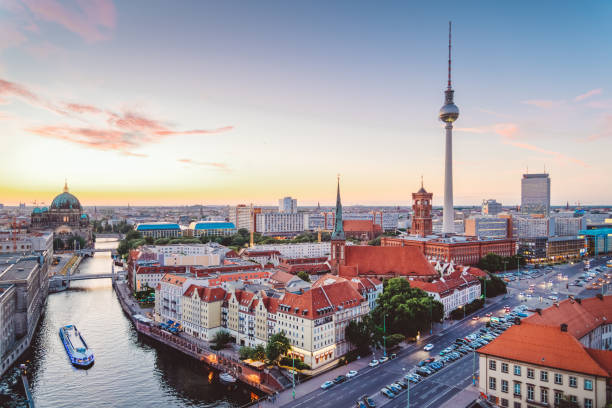 skyline of berlin (germany) with tv tower at dusk - germany stock pictures, royalty-free photos & images
