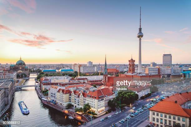 skyline of berlin (germany) with tv tower at dusk - central berlin stock photos and pictures
