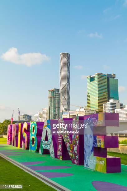 skyline of brisbane with the g20 brisbane sign at south bank, queensland, australia - brisbane stock pictures, royalty-free photos & images