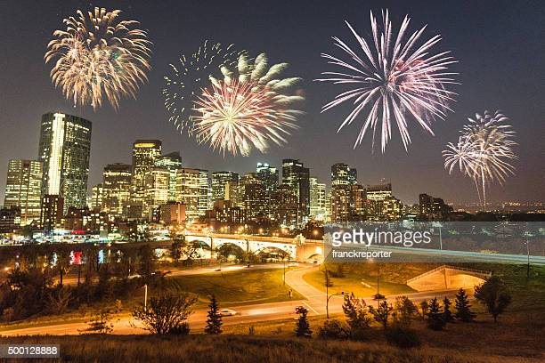 skyline of  calgary with fireworks for the new year - calgary stock pictures, royalty-free photos & images