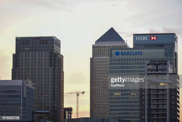 Skyline of Canary Wharf is pitured as the sun sets, in London on November 17, 2017. Several banks and financial enterprises are threatening to leave...