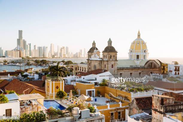 skyline of cartagena with the church of san pedro claver and monastery and the modern building of bocagrande in the background. cartagena de indias, colombia. - colombia fotografías e imágenes de stock