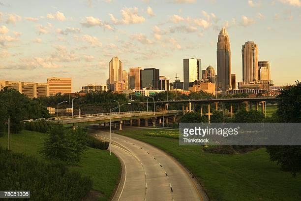 skyline of charlotte, north carolina - thinkstock stock-fotos und bilder