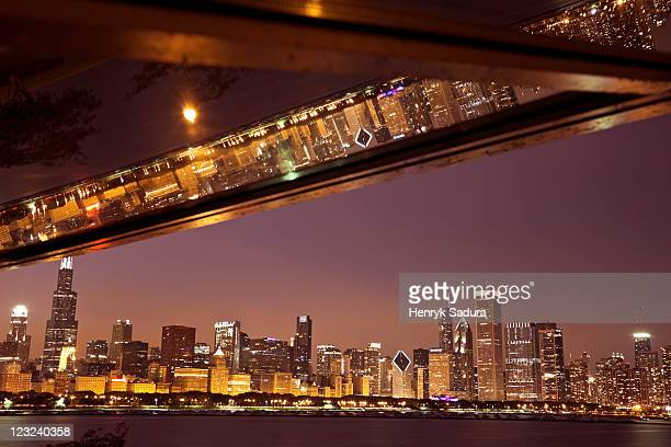 Skyline of Chicago reflected in window