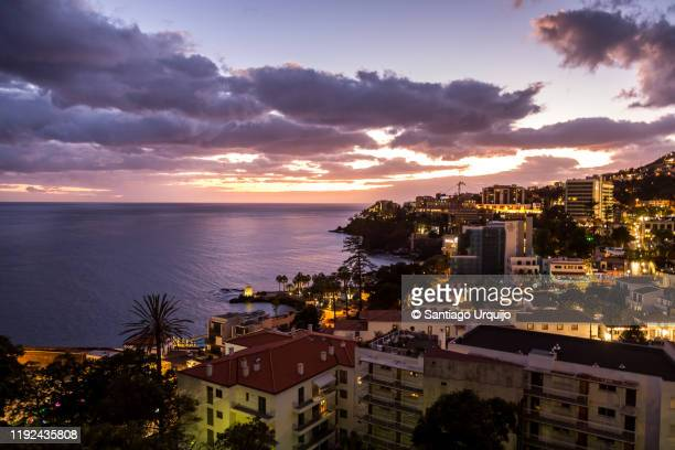 skyline of coastline of funchal at sunset - lareira stock pictures, royalty-free photos & images