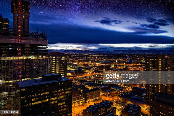 skyline of denver at dusk from downtown - denver stock photos and pictures