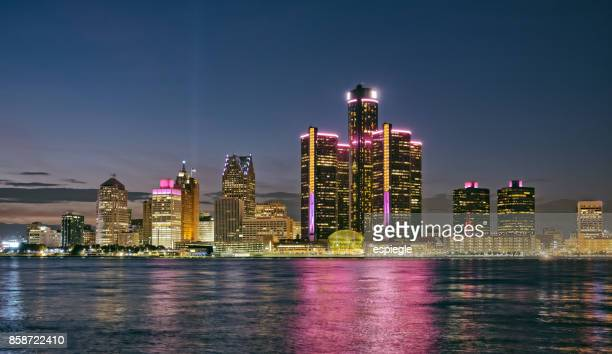 skyline of detroit at night, michigan - detroit river stock photos and pictures