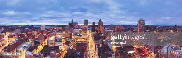 skyline of detroit michigan at sunset aerial - detroit stock pictures, royalty-free photos & images