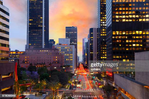 skyline of downtown la at sunset with traffic - la waterfront stock pictures, royalty-free photos & images