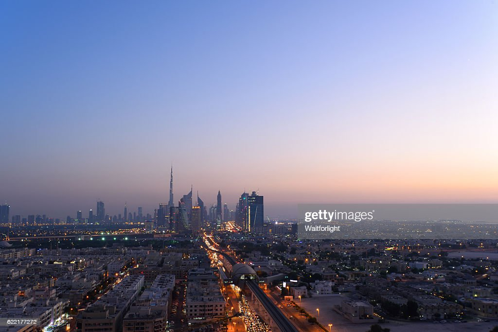 Skyline Of Dubai At Sunset Stock Photo | Getty Images