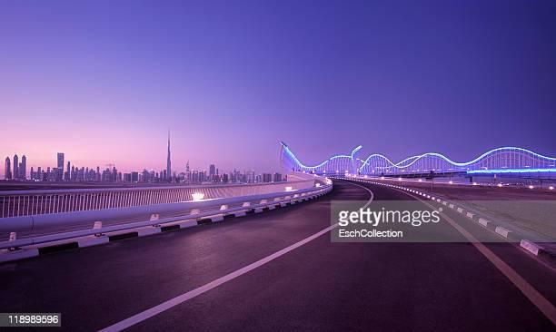 skyline of dubai with futuristic bridge, uae - image stock pictures, royalty-free photos & images