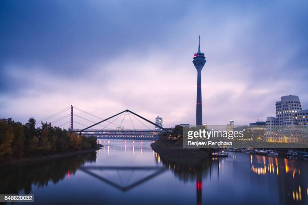 skyline of dusseldorf, germany over the river rhine at twilight - north rhine westphalia stock pictures, royalty-free photos & images