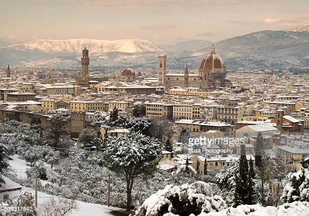 Skyline of Florence in winter with snow, as seen from Piazzale Michelangelo. Tuscany, Italy