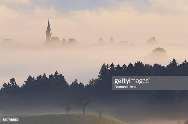 Skyline of foggy village, Canton Zurich, Switzerland