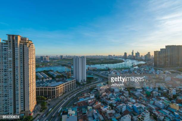 skyline of ho chi minh city at evening, vietnam view from thu thiem district. - thiem foto e immagini stock