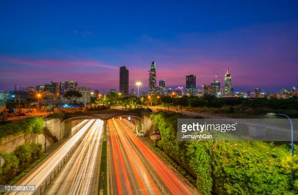 skyline of ho chi minh city by night from the thu thiem tunnel - thiem stock pictures, royalty-free photos & images