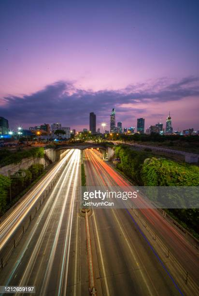 skyline of ho chi minh city by night from the thu thiem tunnel vertical - thiem foto e immagini stock