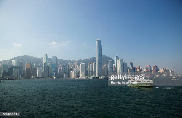 skyline of hong kong and victoria harbour - star ferry stock photos and pictures